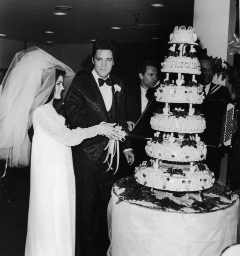 **1967: PRISCILLA BEAULIEU PRESLEY**   Ready for a big surprise? Elvis Presley's wife Priscilla Beaulieu actually designed her *own* dress for the pair's Las Vegas wedding — and it was a dramatic one, featuring chiffon, beads and a three-foot veil.