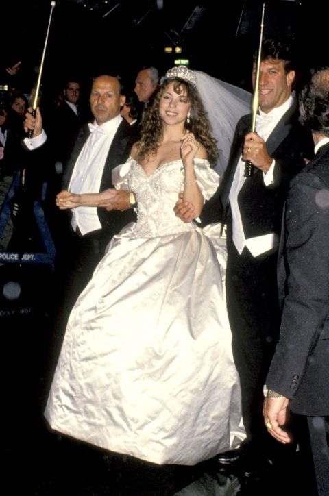 **1993: MARIAH CAREY   **In a lavish affair on June 5, 1993, singer Mariah Carey married Sony Music's Tommy Mottola wearing a massive $25,000 Vera Wang gown with a 27-foot-long train. That's right, *27 feet* of fabric. The couple divorced just four years later.