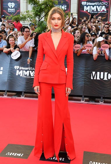 Gigi Hadid won at life on the iHeartRADIO Music red carpet overnight in this stunning scarlet pant suit.