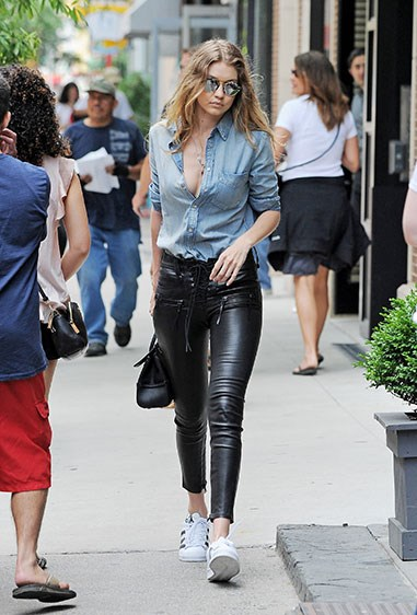 Of course, Gigi's off-duty looks are equally on-point, with leather pants and shiny white kicks the order of the day.