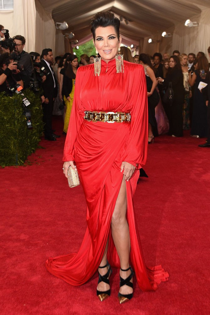 Last year's Met Gala 'China: Through The Looking Glass' saw Mama Kris rock the shit out of a thigh high split, sharp 80's style shoulders and statement AF earrings.