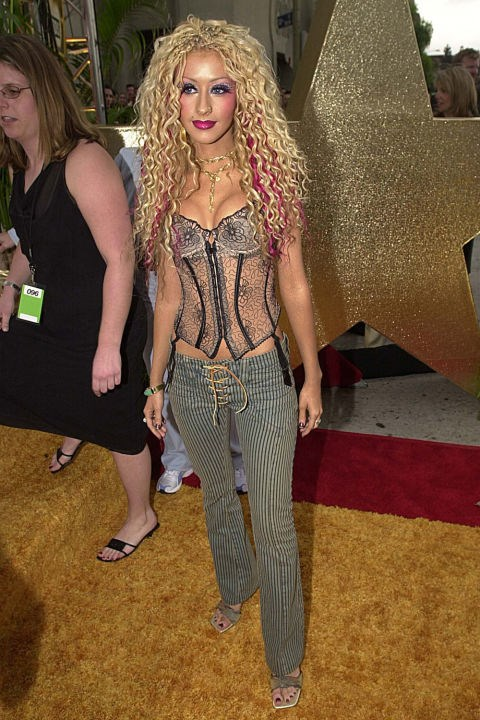 **PANTS WITH LACE-UP-CROTCHES   **Low rise, of course. Mandatory-bikini-wax low.    *Christina Aguilera at the MTV Movie Awards on June 2, 2001.*