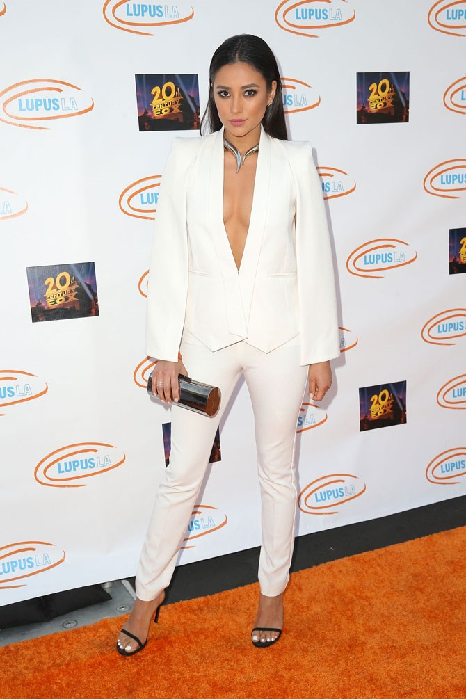 Ditch your black suit for a white caped version instead. Shay has spoken.