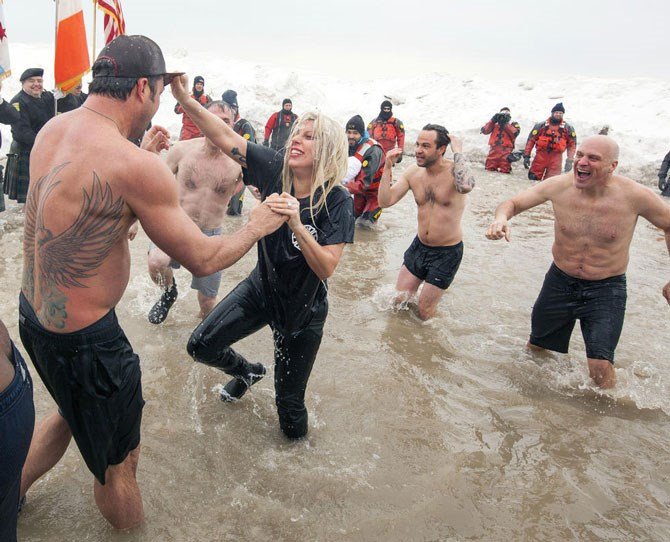 7. *thefeels* Gaga and Taylor wrestling in an ice cold water for a charity event