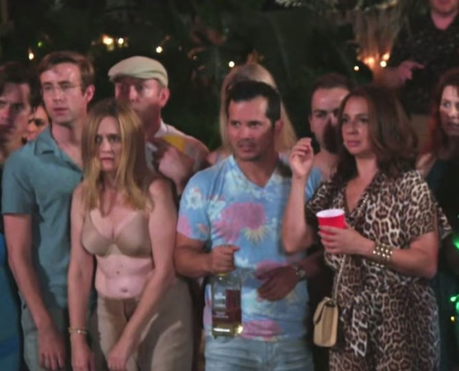 **7. Liz and Rob having sex (to completion!) in the crowd in *Sisters*.** While the party looks on at the sinkhole in Maura and Kate's backyard, Liz and Rob (played by Samantha Bee and Matt Oberg) decide to discretely do it from behind. In a matter of minutes, with no thrusting or movement whatsoever, the couple climaxes ... simultaneously. I could also tear down the slim likelihood of that ever happening, but we can't hang around here all day.