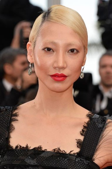 """**BEIGE BLONDE** This """"flesh-toned blonde shade,"""" as Friedman refers to it, is way to transition your cool platinum colour into a warmer spring tone, like model Soo Joo Park's, without losing the statement of a platinum blonde. But Friedman doesn't recommend trying to achieve this colour at home. If you're not this light blonde yet — or even if you are — she suggests talking to your colourist about taking your hair colour to this shade."""