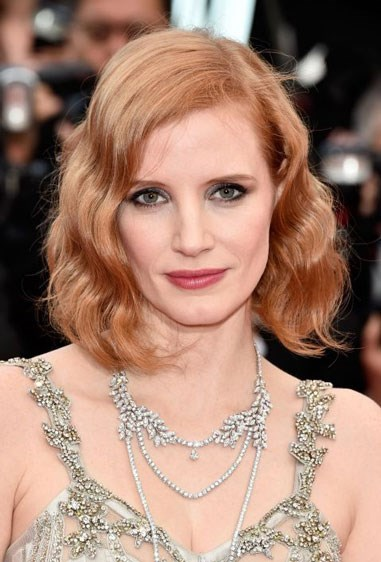 """**TERRACOTTA** Terracotta hair colour, like Jessica Chastain's, is gorgeous and multidimensional because it's a burnt brown meets reddish-orange with a pink undertone, Friedman explains. It's not the brightest shade, it's more muted, but still beautiful. To get the look, if you have darker hair, talk to your colourist about going lighter; if you're already blonde, look for terms like """"terracotta"""" and """"medium auburn"""" on box kits."""