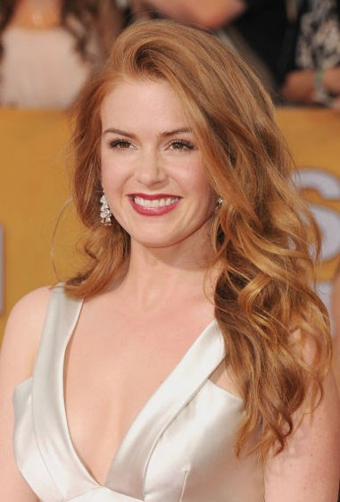 """**CHAMPAGNE-Y RED** If you're a darker blonde and want to see how you feel as a sexy siren, like Isla Fisher, go for a champagne-y red shade. You can go to this shade easily from your previous hair colour and not feel like you've done too much of a crazy change. Look for terms like """"copper"""" and """"strawberry"""" on at-home box kits."""