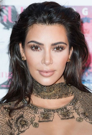 """**DEEP BROWN WITH RED ACCENTS** If you want a deep brown hue with a reddish cast, similar to Kim Kardashian's hair colour, then go for a shade that's dark brown with hints of deep auburn. Look for terms like """"deep brown/auburn"""" or """"dark auburn"""" on at-home box kits."""