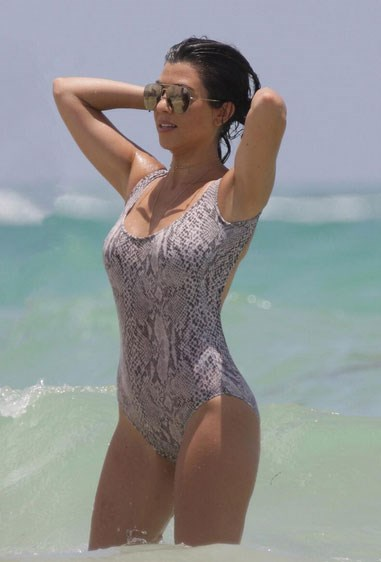 And posing up a storm in a one-piece because why not?