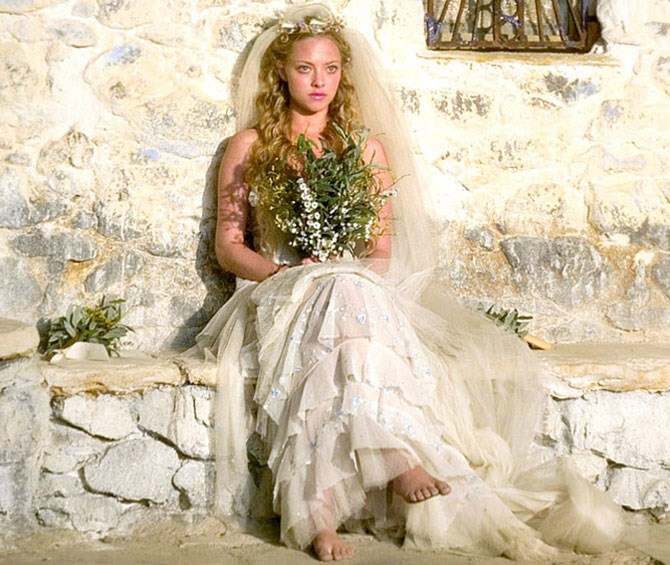 **6. Sophie - *Mamma Mia*** Sophie's boho-inspired, tiered tulle maxi, complete with intricate floral detailing never fails to WOW us every single time we watch *Mamma Mia* (sing-along version, obvs). We still have NFI how she managed to source such an amazing gown on that tinsy island but meh. It was pretty.