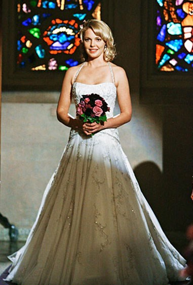**Izzie Stevens - *Grey's Anatomy*** The beaded, dropped-waist dress Izzie wore to wed Alex gave us serious LIFE, and totally transformed the doc we only remember seeing wearing scrubs into an absolute goddess. Side note: the halterneck neckline choice was risky but, IMO, she totally pulled it off.