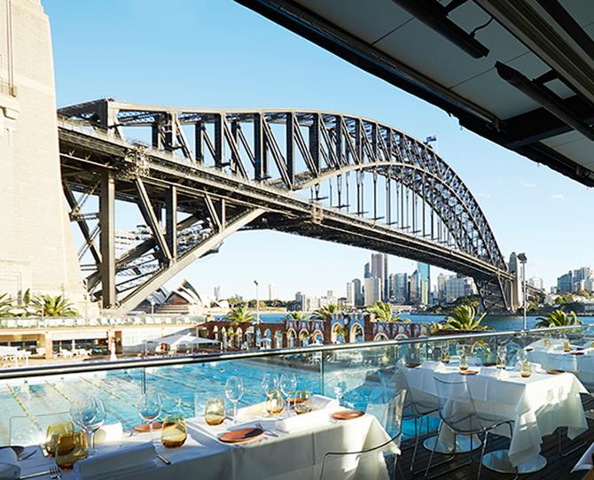 **NEW SOUTH WALES** **Aqua Dining, Milsons Point**  [**aquadining.com.au**](http://www.aquadining.com.au)   **Why it's amazing:** The Olympic poolside locale with one-of-a-kind views of Sydney harbour will truly wow your guests. You couldn't get much closer to the bridge than this spectacular location. The outlook is unrivalled, as is the service – they've won too many awards to mention.   **And there's more:** The stellar restaurant uses fresh Australian produce to create a modern Italian menu. Treat your guests to delicious fresh pasta packed with the best quality seasonal ingredients.