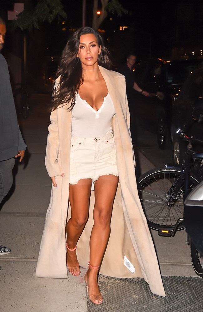 HOLY WOAH. Kim got her money's worth out of her VMAs spray tan by rocking a tiny all white outfit the next day. Babe much?