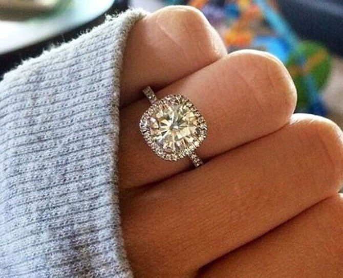 "**9.** Cushion cut halo ring ([via](http://www.deerpearlflowers.com/20-most-loved-cushion-cut-engagement-rings/dream-engagement-ring-perfection-cushion-cut-halo-with-a-thin-band-with-diamonds-on-the-band/|target=""_blank""))."