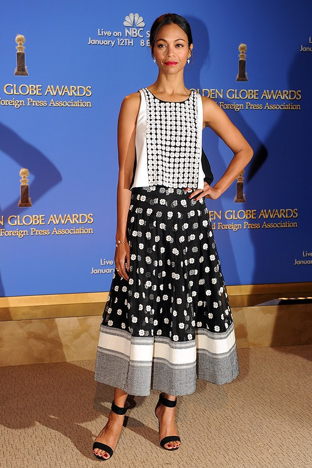 Zoe Saldana makes monochrome interesting in a slightly mis-matched graphic two-piece. An interesting headband would be all you need come Derby Day.