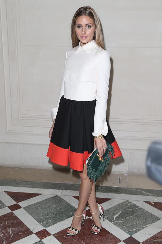Olivia Palermo proves the versatility of the white shirt. Wear it top-buttoned and tucked into a colour-blocked skirt for a chic take on races dressing. BYO bunny ears headpiece.