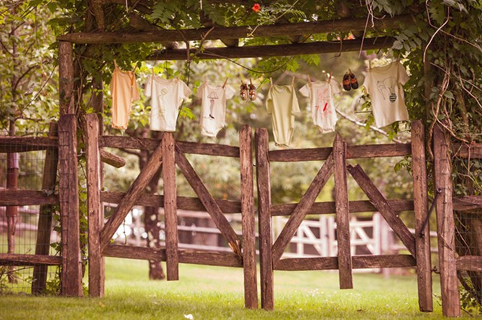 Cute decorations: A clothesline with baby shoes and little onesies