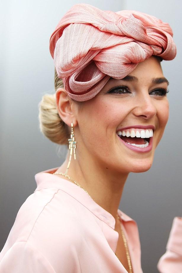 A flat, hairline-sitting headpiece like Ashley Hart's is best offset by an elegant side bun.