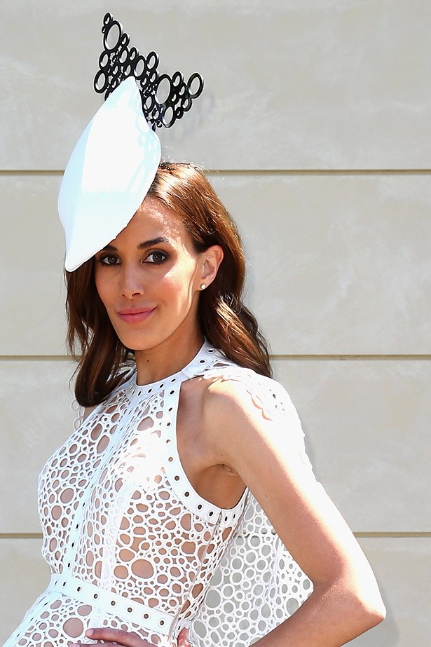 Rebecca Judd balances a sculptural headpiece with old hair-tucked-behind-the-ear trick. Paired with loose waves, it lets her topper shine.
