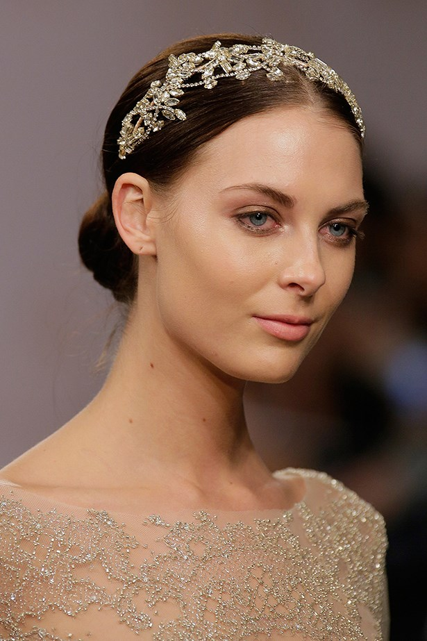 If you're thinking of incorporating some bridal bling into your hair, keep locks low-key with a chic centre-parted ballerina bun, a la Monique Lhuillier's bridal fashion show. <br><br> Monique Lhuillier bridal fashion week autumn winter 2015
