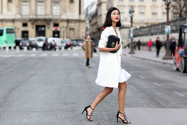 A long-line drazer makes a chic cover-up for flitting between shows during Paris Fashion Week.