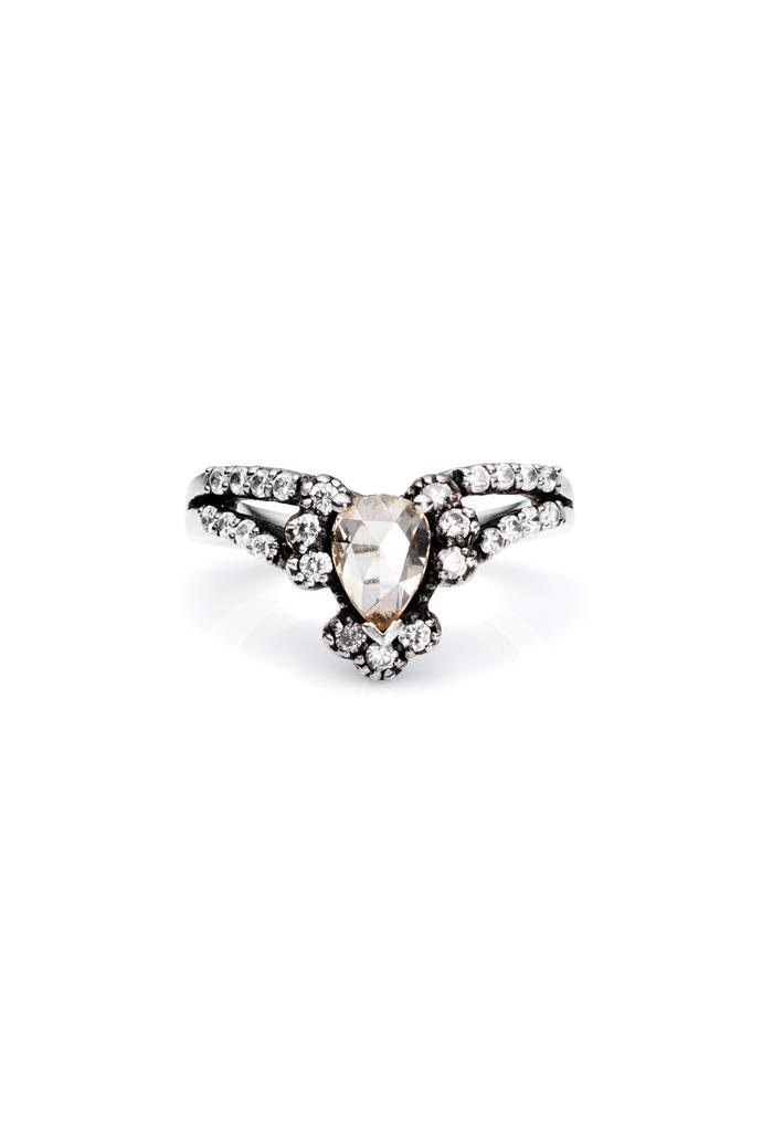 """Ring, $7,200, Mania Mania, <a href=""""http://www.themaniamania.com/shop/immortalia/ritual-solitaire-ring-white-gold-diamond """">themaniamania.com</a>"""