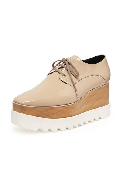 """Shoes, $995, Stella McCartney, <a href=""""http://www.neimanmarcus.com/Stella-McCartney-Faux-Patent-Platform-Oxford-Nude-Shoes/prod170320224_cat40280756__/p.prod?icid=&searchType=EndecaDrivenCat&rte=%252Fcategory.jsp%253FitemId%253Dcat40280756%2526pageSize%253D120%2526No%253D0%2526refinements%253D&eItemId=prod170320224&cmCat=product"""">neimanmarcus.com</a>"""