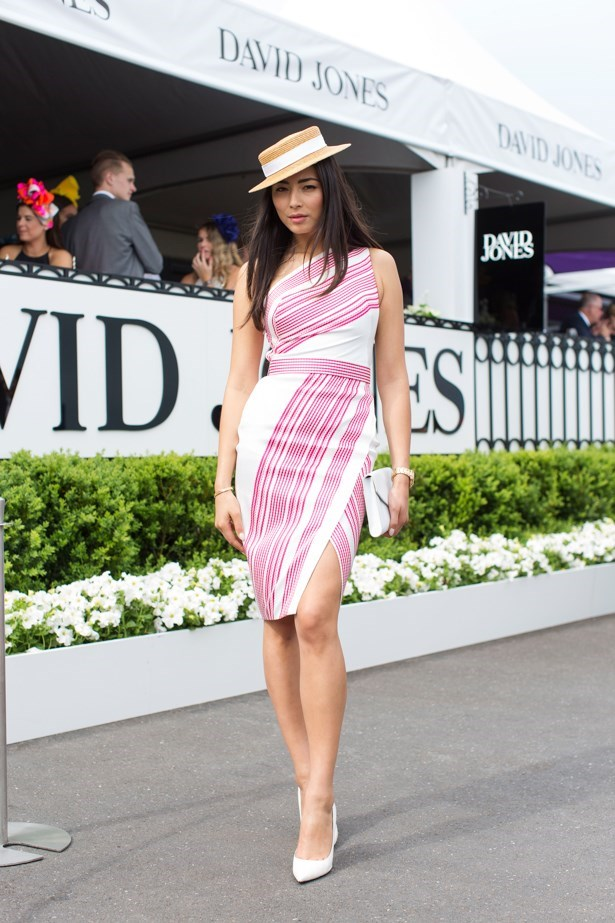 Members stand fashion for the races