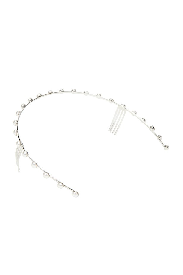 """""This delicate headpiece would be the crowning glory of any race day ensemble."" - Alison Parr, freelance contributor <br><br> Headpiece, $239.95, Sarina Suriano, <a href=""http://www.greenwithenvy.com.au/product_details.php?id=SSOH13#"">greenwithenvy.com.au</a>"