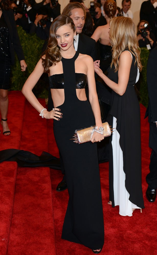 Looking sleek in a black cut-out number in at Met Gala in 2013.