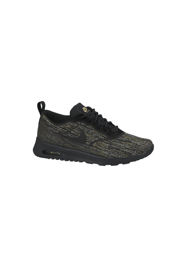 "Sneakers, $160, Nike, <a href=""http://www.stylerunner.com/shop/product/654170-002blackgold/nike-air-max-thea-jacquard-blackmetallic-gold-sail.html"">stylerunner.com</a>"