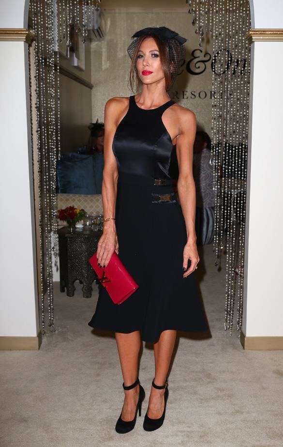 An LBD will always be appropriate. Add a red lip and clutch, then top with a dainty headpiece for extra Cup day points.