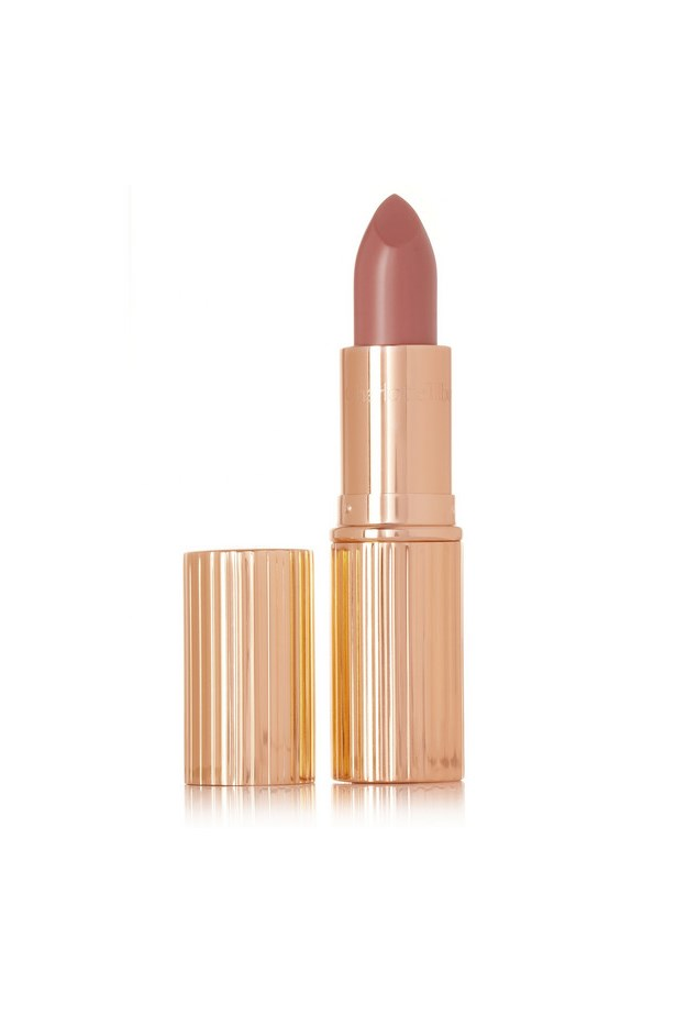 """A hit of sheen (but not gloss) and warm coral undertones makes this a natural-looking choice if you need your nude on the warmer side. <br><br> K.I.S.S.I.N.G Lipstick in B*tch Perfect, approx $42, by Charlotte Tilbury at <a href="""" http://www.net-a-porter.com/product/420991/Charlotte_Tilbury/k-i-s-s-i-n-g-lipstick-b-tch-perfect"""">Netaporter</a>"""