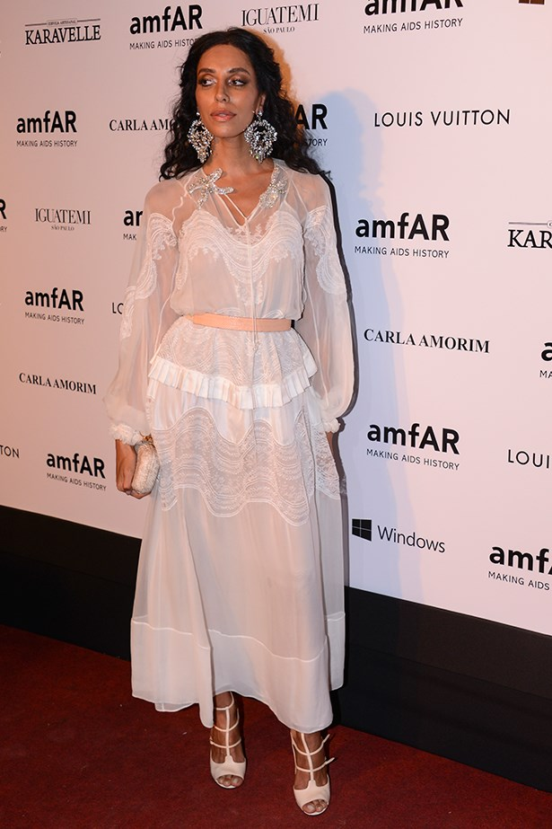 An embroidered voile white dress made for a pretty choice for amfAR's Inspiration Gala in Sao Paulo in April. Note those earrings. #bling