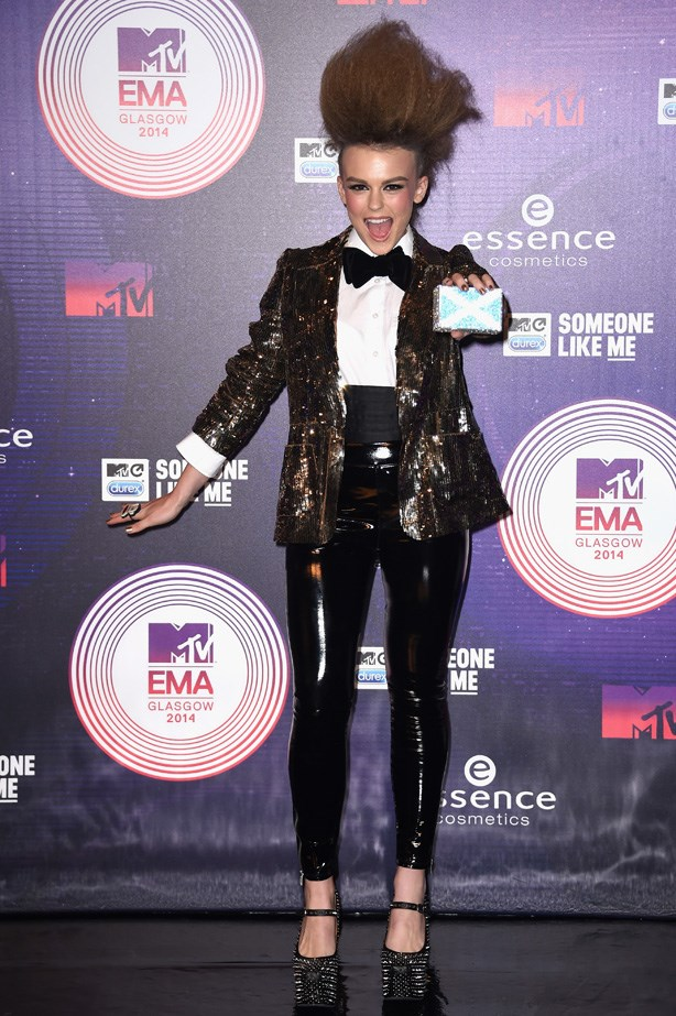 A sequinned blazer, high-shine leggings and spiked platform pumps puts a brazen spin on Tallia Storm's tuxedo-inspired look.