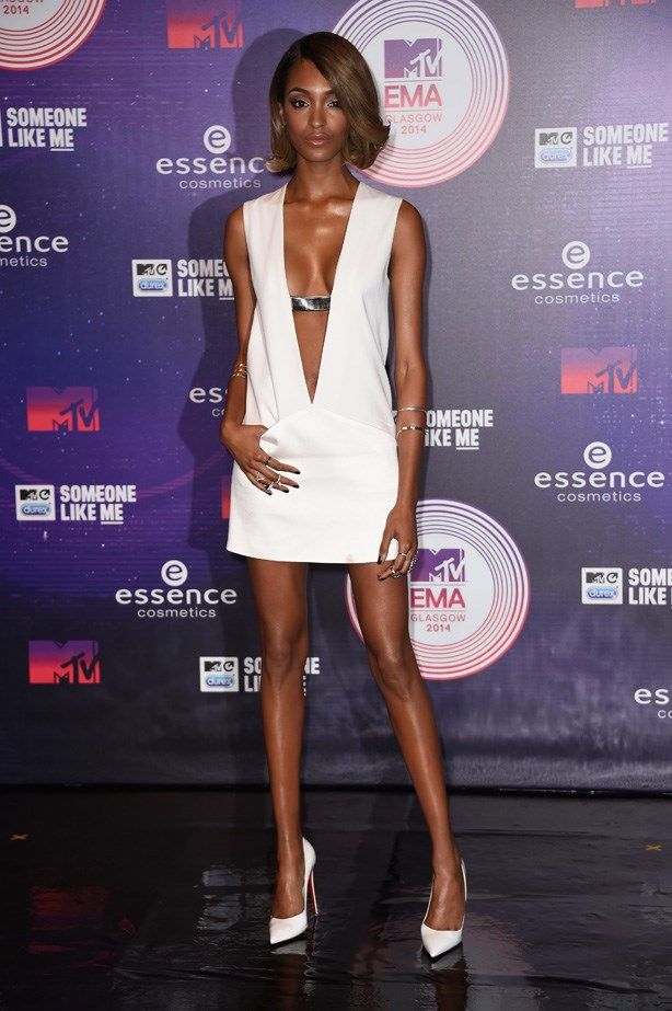 Model Journdan Dunn was all legs and cleavage in this sharp white mini dress.