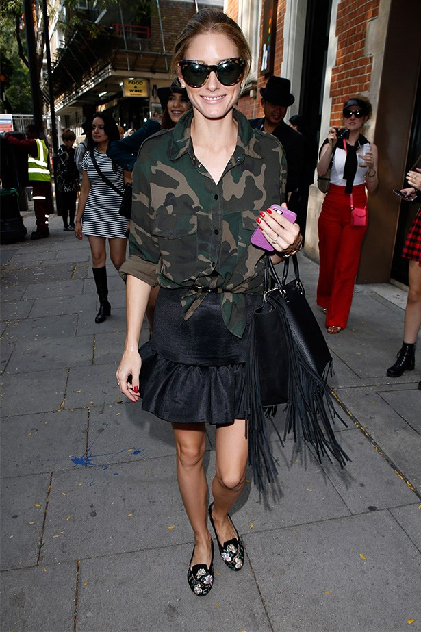 Want to put a feminine spin on a somewhat masculine trend? Pair a camouflage shirt with a pep-hem skirt.