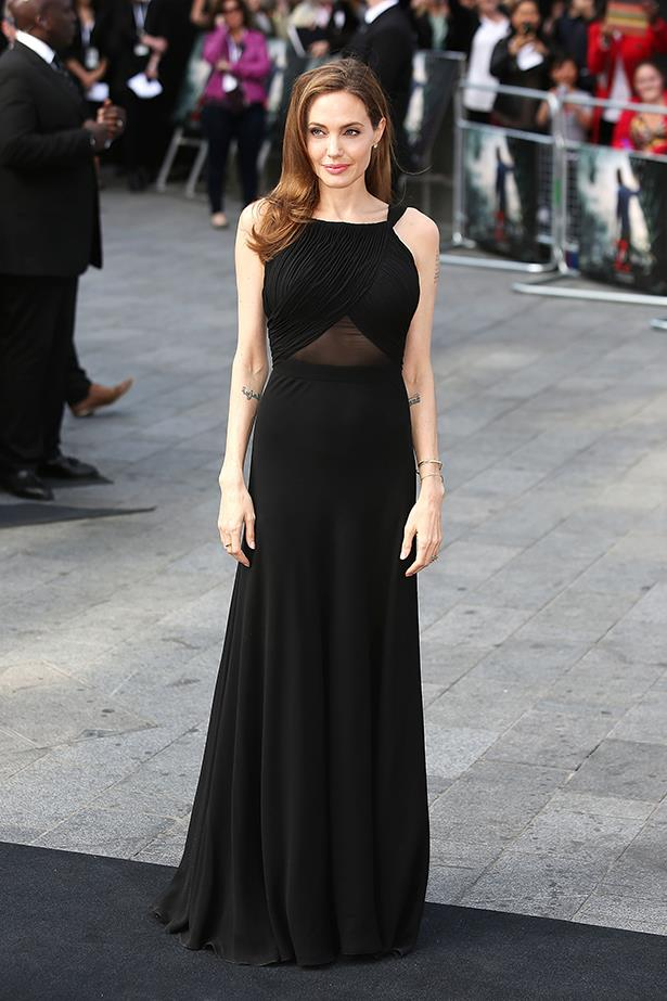 Angelina Jolie, wearing a black Yves Saint Laurent column gown, at the World Premiere in of <em>World War Z</em> in London, June 2013