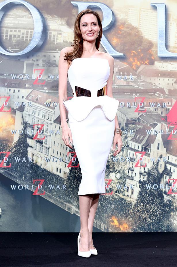Angelina Jolie at the German premiere of <em>World War Z</em> wearing a white peplum Ralph & Russo dress, June 2013