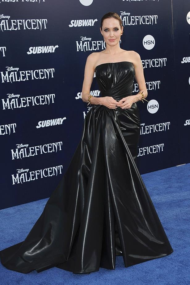 Angelina Jolie wears a gown by Versace at the Hollywood premiere of her film <em>Maleficent</em>, May 2014
