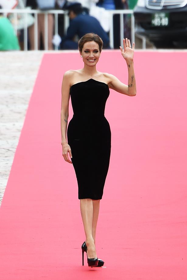 Angelina Jolie looks chic in a simple black dress at the Japanese premiere of <em>Maleficent</em>, June 2014