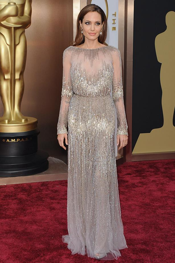 Angelina Jolie attends the 2014 Academy Awards in an embellished column gown by Elie Saab