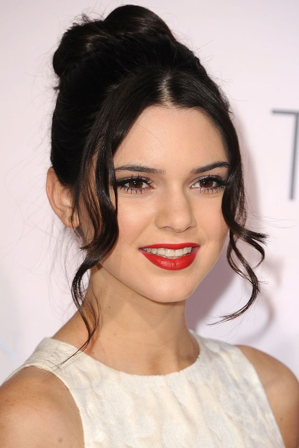 Early in 2012 Jenner paired a bold red lip with a loose bun and lots of mascara.