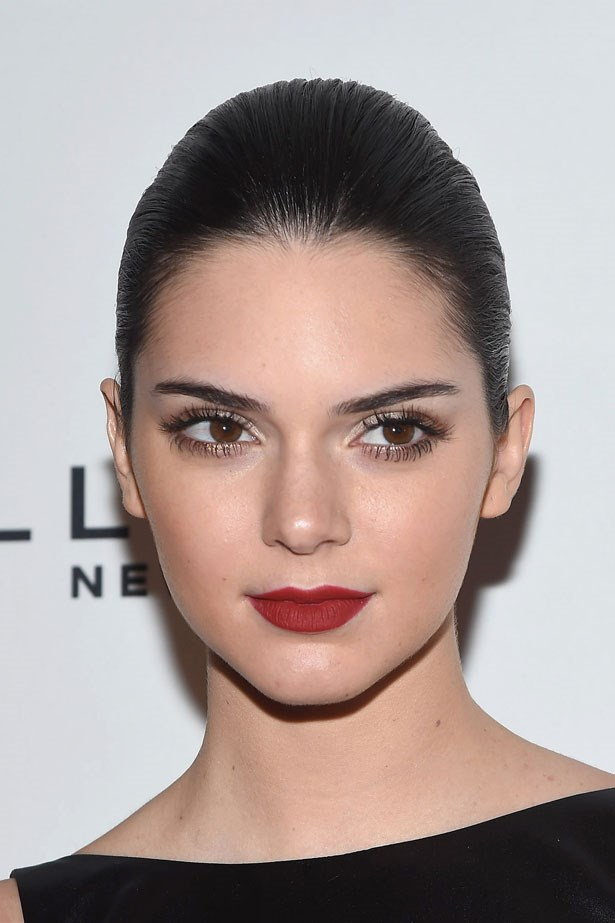 Kendall kept her look classic with spidery lashes, a matte red lip and slicked back hair in 2014.