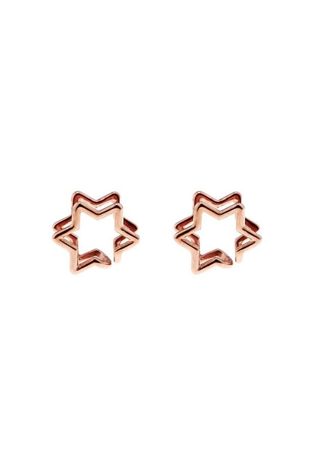 "Ear cuffs, $206, Coops London, <a href=""http://www.matchesfashion.com/product/207595"">matchesfashion.com</a>"