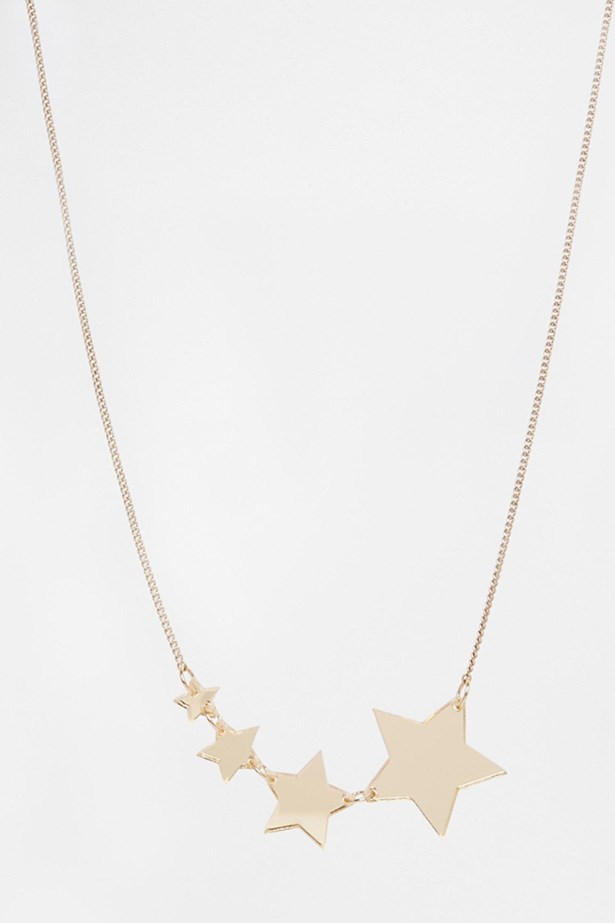 """Necklace, $48, ASOS, <a href=""""http://www.asos.com/Tatty-Devine/Tatty-Devine-Exclusive-For-ASOS-Gold-Shooting-Star-Necklace/Prod/pgeproduct.aspx?iid=4608007&CTARef=Recently%20Viewed """">asos.com</a>"""