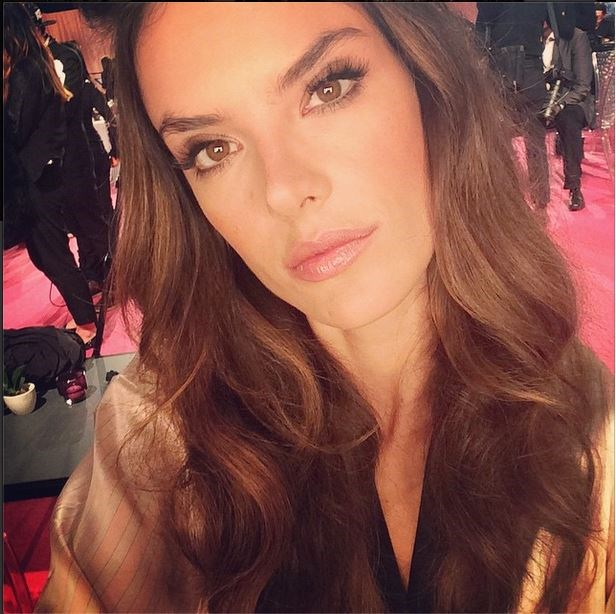 Alessandra Ambrósio snaps a selfie while waiting backstage.