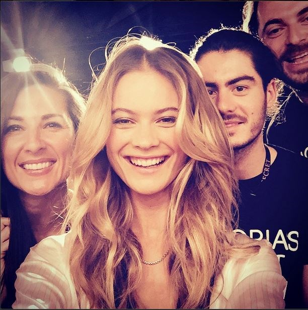 Behati Prinsloo goes for an 'Ellen-at-the-Oscars' photo with her hair and makeup artists.