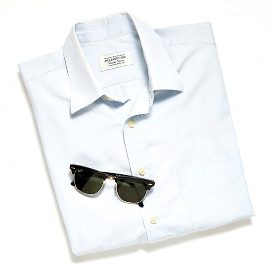 "A good button up shirt (this is a vintage men's one but try <a href=""http://www.net-a-porter.com/product/488400/APC_Atelier_de_Production_et_de_Creation/audrey-striped-cotton-shirt"">A.P.C.</a>) and a pair of <a href=""http://www.sunglasshut.com/au/805289653653"">Ray-Ban Clubmasters</a>."